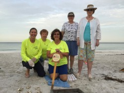 Members Kathy Doddridge, Registrar, Mary Breaux, Fran Kramer, Conservation Chair excavate our turtle nest with Regent Spry and Julie Moore